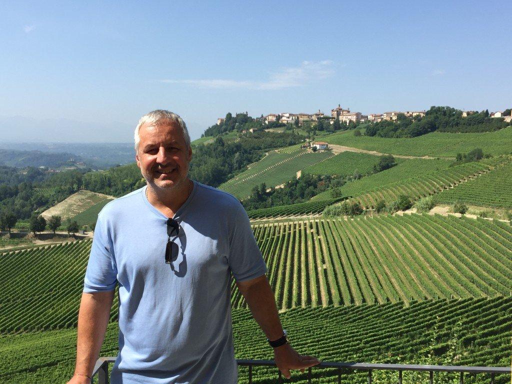 Kamil Majer overlooking vineyards in the Piemonte