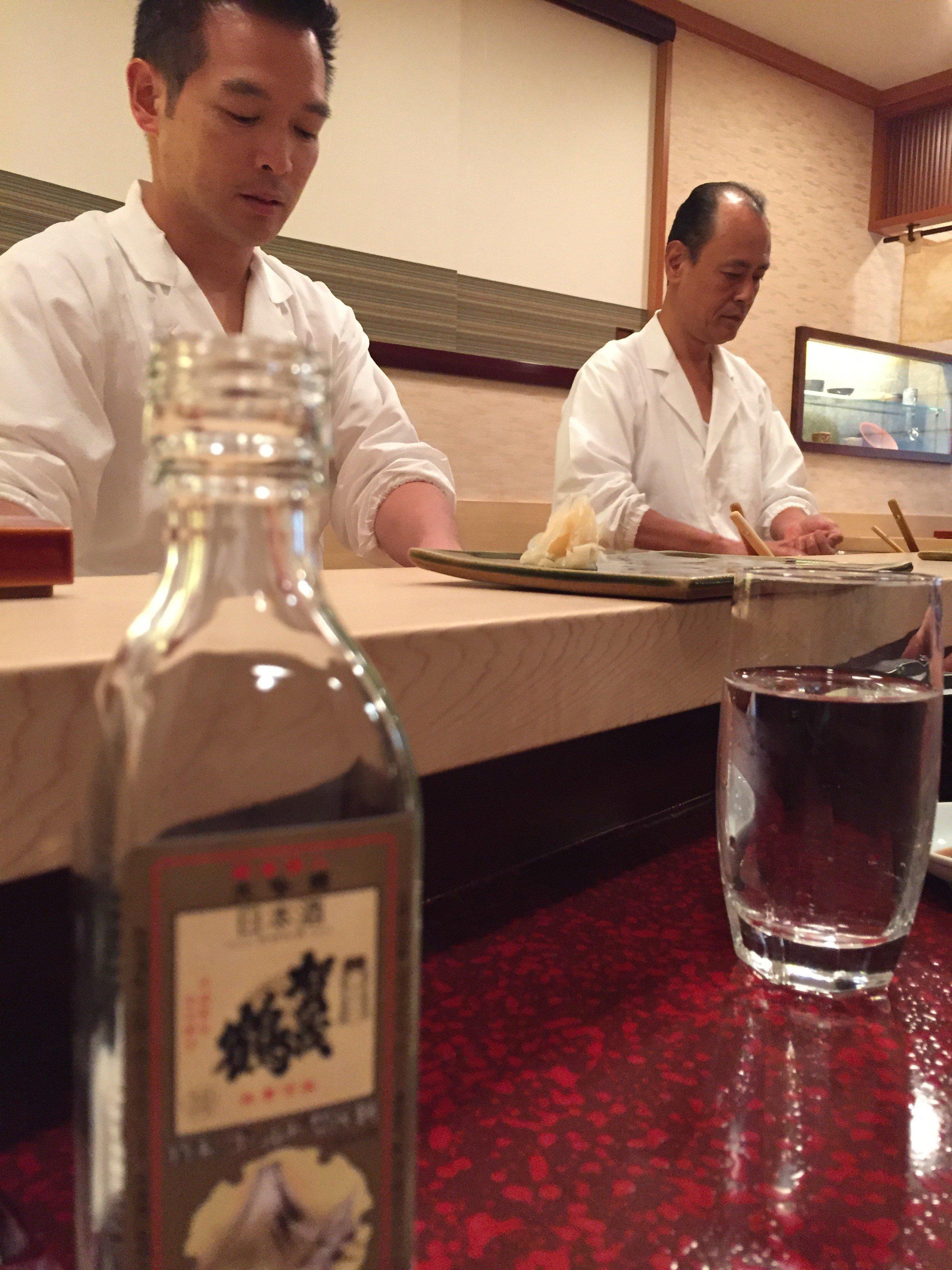 Sushi chefs at work at Hiro-Sushi, Japan